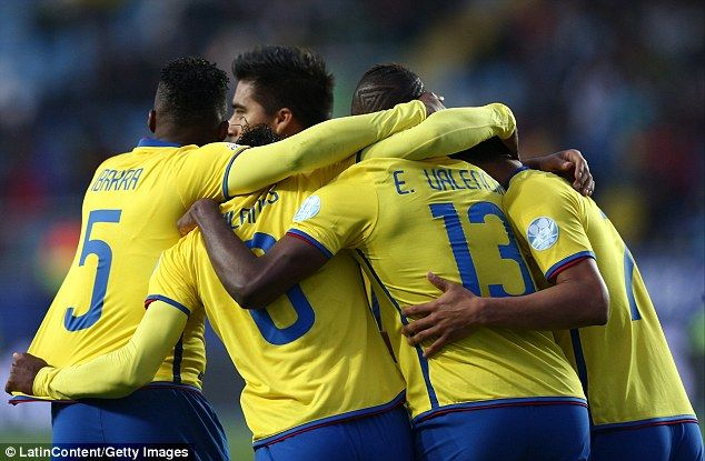 Miller Bolanos is congratulated by his Ecuador team-mates after scoring the first goal of the game.Copa America Chile 19.6.15