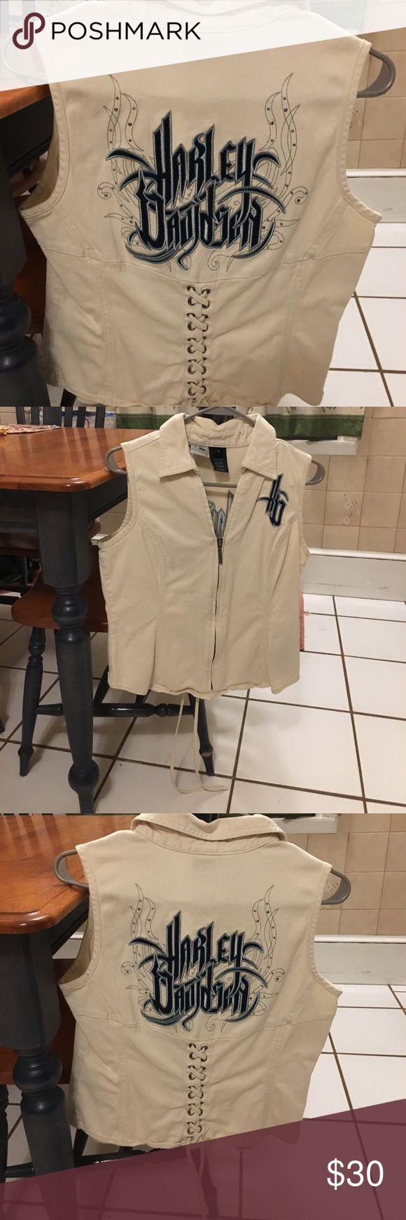 H-D Womens Cream Shirt/Vest.  Size Med. Used.  Women's Harley-Davidson cream shirt/vest with cute design and criss cross tie on back and HD emblem on front.  Size Med. Harley-Davidson Tops