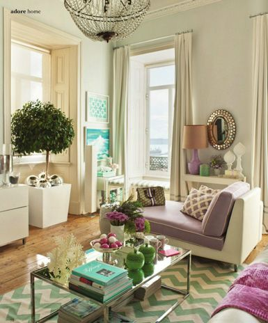 The soft color palette of this room is sophisticates, feminine and modern.  Plus, the chevron rug is a bonus!