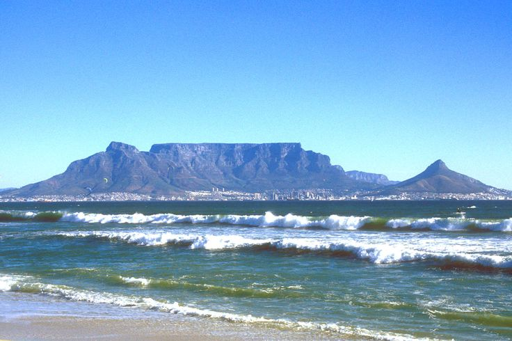 Table Mountain's flat top was formed 300 million years ago. The mountain was at sea level during an ice age and ice sheets flattened the layers of sandstone to form the famous landmark.