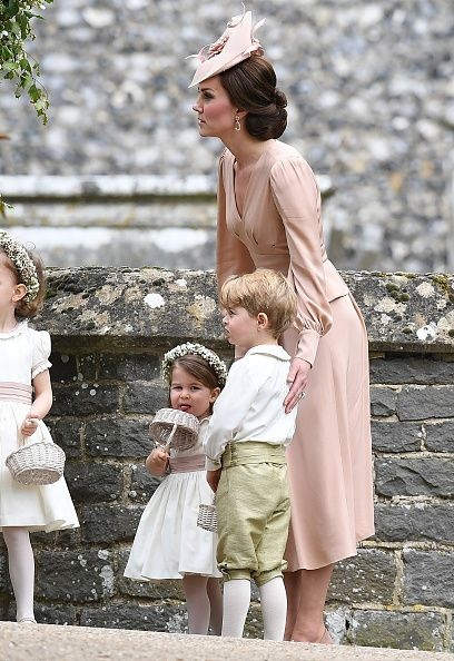Catherine, Duchess of Cambridge, with Prince George of Cambridge (R), page boy and Princess Charlotte of Cambridge (R), bridesmaid, after the wedding of Pippa Middleton and James Matthews at St Mark's Church on May 20, 2017 in Englefield Green, England.