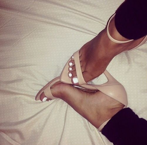 White nails nude shoes.