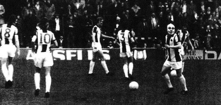 Circa 1977/78. West Bromwich Albion's wayward winger Willie Johnston livens up the warm up with a joke mask.