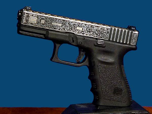 Outrageous Engraved, Gold-Plated Glock (10 PHOTOS)   Alternative