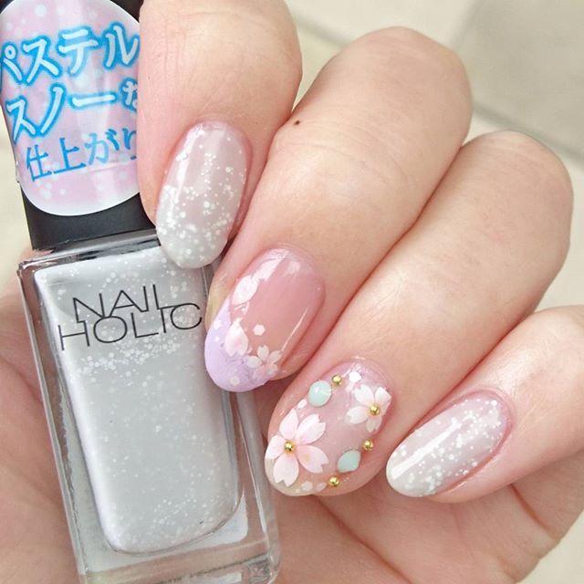 #ネイルホリック 新色と#しずくネイルシール を使って春を意識した#桜ネイル 🌸 桜の花びらシールに#タフィーネイル でピンクを足しお化粧してみました♡中指の花びらはシールを切り離して使い、桜吹雪をイメージ🌸全体的にパステルカラーでカラフルに✨ お花見行きたいなぁ♡  ネイルホリック #GY050 #PU101 OPI #petalsoft #キャンドゥ タフィーネイル  #セルフネイル #セルフネイル部 #nailholic_kose #パステルスノー #しずくドリーミング3 #春ネイル #桜 #桜吹雪 #ネイルホリック_美スギ #nailholic_misugi #フレンチネイル #斜めフレンチ #変形フレンチ #入学式ネイル #和柄ネイル #パステルネイル #ローリエプレス #しずくネイルシールコンテスト2