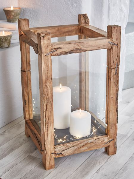 This beautifully hand-crafted, extra large wood candle lantern is an undeniable statement piece.
