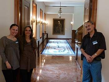 A glimpse inside the Universal House of Justice, showing a portrait of 'Abdu'l-Baha, one of the three central figures of the Baha'i Faith. A special day at the Baha'i World Center with my wife Kahurangi, my daughter Willow, and myself Ash Davison.