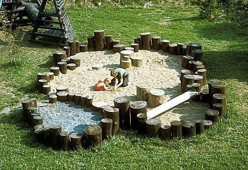 Cool sandbox with wooden boarder to climb around