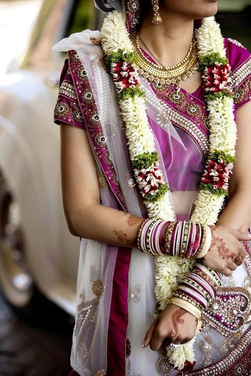 This simple jaimala still works wonders :) #Indianwedding #weddingphotograph #garland | Curated by #WittyVows - The ultimate guide for the Indian Bride | www.wittyvows.com
