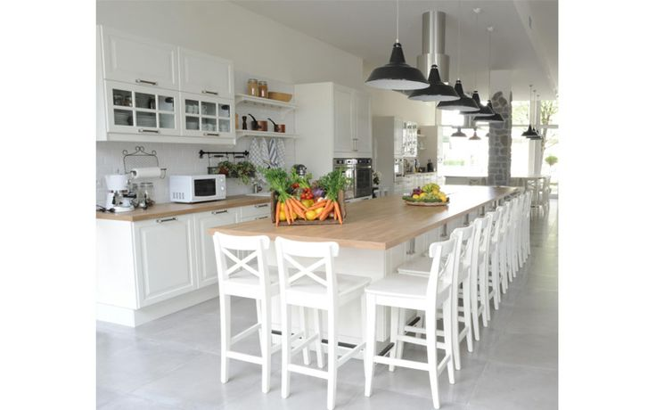 A nice shabby chic cooking school by Nomade Architettura http://www.nomadearchitettura.com/#all  #white furniture #stone flooring #blackindustriallighting