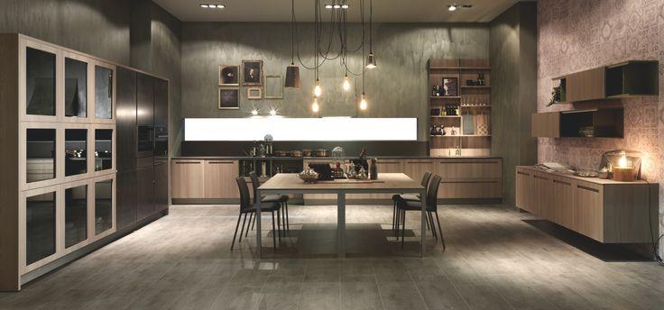 Mood di Stosa è la cucina moderna che disegna lo spazio giorno unendo kitchen e living con una soluzione di continuità dallo stile sofisticato e discreto. La nuovissima finitura impiallacciata olmo, nei due colori naturale e cenere, presenta un nuovo stile in cucina, contraddistinto da un'eleganza estetica e funzionale allo stesso tempo, con spazi ampi e personalizzabili, che aprono la zona cucina al resto della casa.