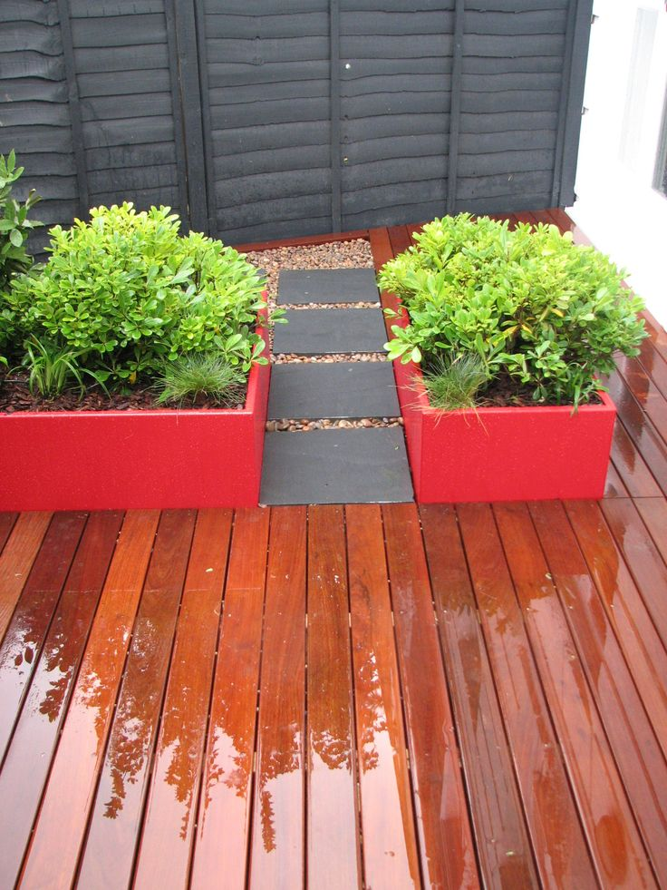 Hardwood decking leading to a slate stepping stone pathway for Garden decking north london