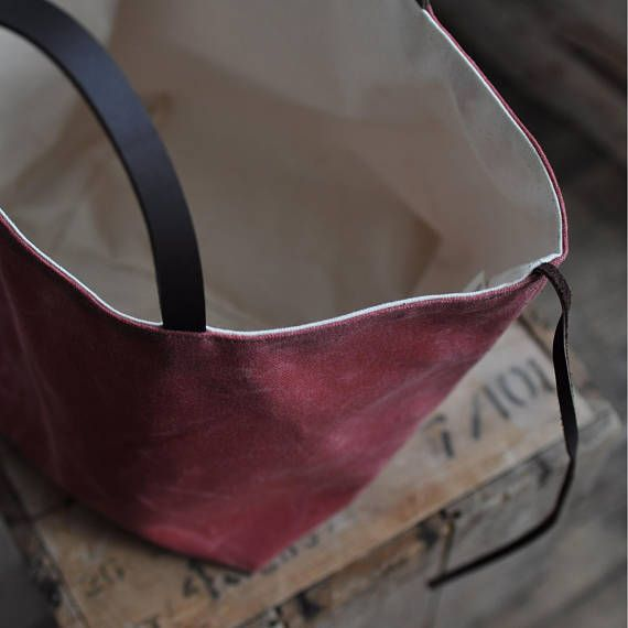 this nice and simple box tote is a great size to carry around and also makes a good project bag the tote can be left open or you can use the leather tie to cinch in the sides, which also works as a closure the box tote is made from waxed canvas fabric FABRIC INFO: outer waxed canvas