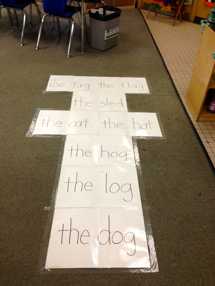 Laminate sight words, CVC words, or phrases and tape to the carpet. Students read them before hopping.