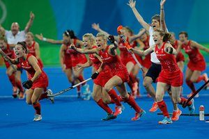 The GB women's hockey team celebrate victory in a penalty shoot-out in the gold…