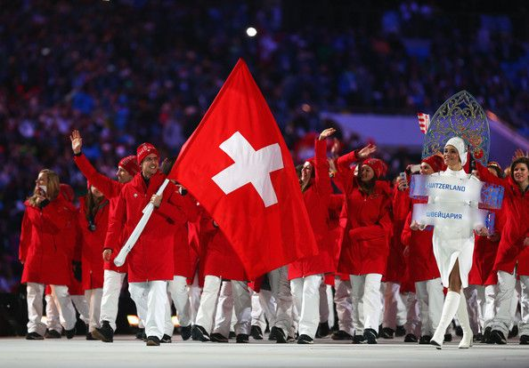 Ski jumper Simon Ammann of the Switzerland Olympic team carries his country's flag during the Opening Ceremony of the Sochi 2014 Winter Olym...