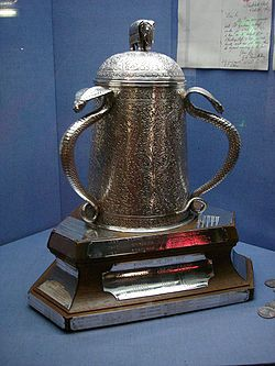 The Calcutta Cup is a rugby union trophy awarded to the winner of the annual Six Nations Championship match between England and Scotland. It is currently England's since the 2009 Six Nations Championship. Since the cup was first competed for in 1879, England has won just over half of the 119 matches, and Scotland has won around one third. The cup itself is of Indian workmanship, decorated with cobras and an elephant. It is now in a fragile state after much mistreatment.