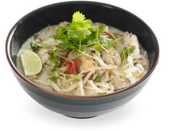 in a spicy green coconut and lemongrass soup topped with stir-fried ...