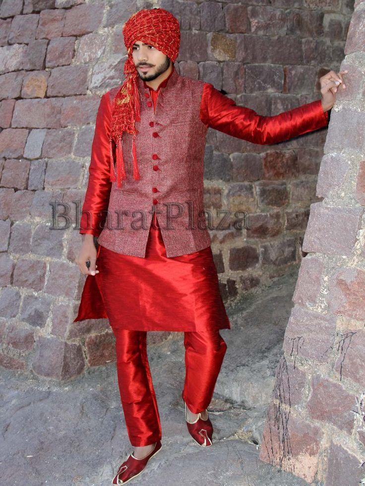 Prominent red color raw silk kurta and churidar pajama is to make a bold statement. Item code: SKB1053WA http://www.bharatplaza.com/new-arrivals/kurta-pyjamas.html