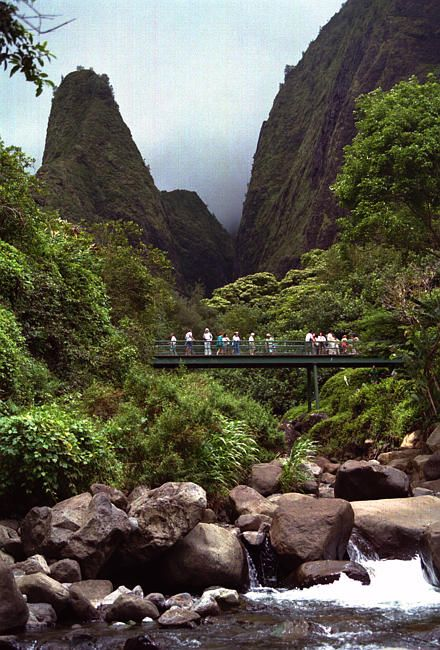 Iao Valley river gorge with people standing on bridge, Maui