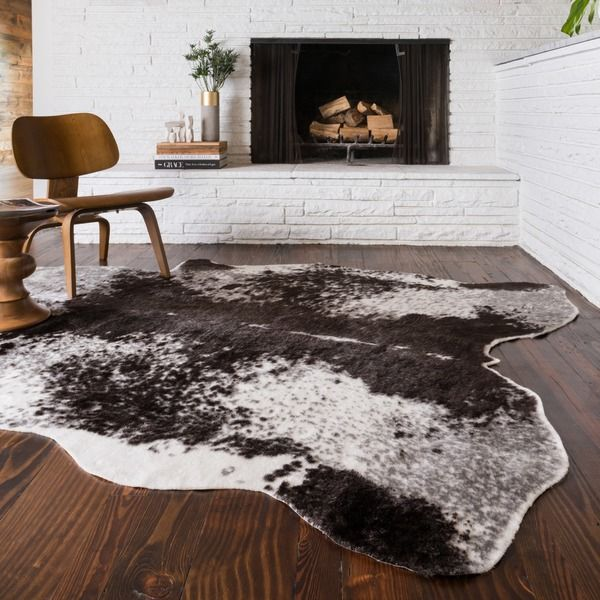 infuse your home with rustic style with this rawhide novelty rugthis faux fur - Faux Fur Rugs