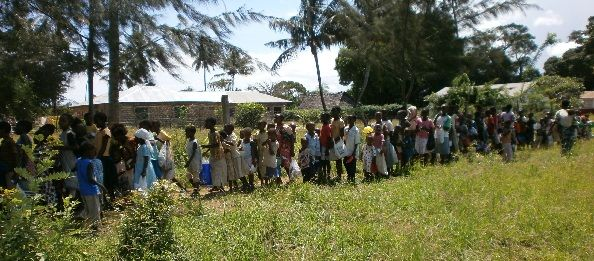 Children queueing for the feeding programme.  500 children now being fed a meal each week, and sent home with a bag of maize flour for the week, to ensure they no longer go three or four days without eating.