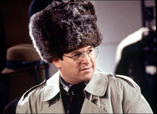 George Costanza, from Seinfeld, looks to wearing a Russian trapper hat of epic proportions.