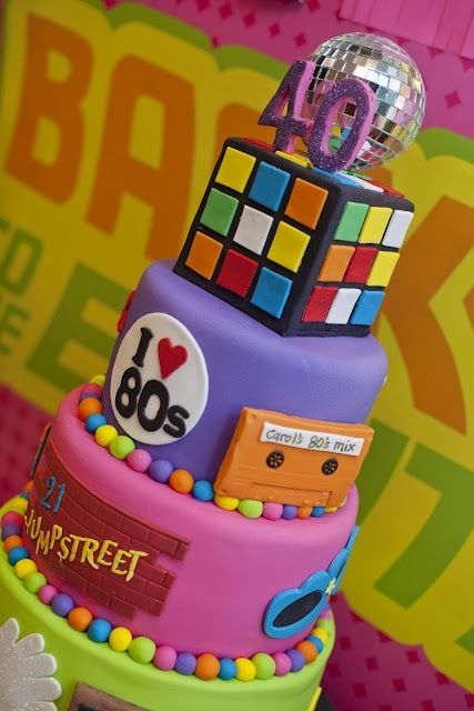 3 tier cake 80's theme for a 40th birthday party. Bright. Does look complicated though.