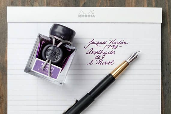 The newest fine Fountain Pen ink from French manufacturer, J. Herbin, Améthyste de LOural, (Ural Mountain Amethyst), a solid dark purple ink in the velvety hue of amethyst with the satin finish of a silver mist for a lustrous shimmering effect and a noble allure. This ink suggest the
