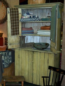Prim Mustard Farmhouse Cupboard...and old textiles.