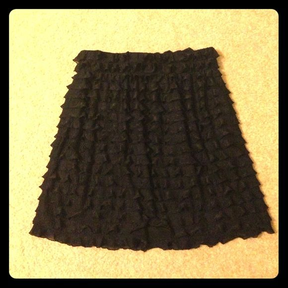 BOGO 50% Cute Black Ruffled Skirt Black ruffled skirt with elastic waistband in new condition. Ruffles start from waistband to bottom, total length of skirt is 16 inches. No holes or stains. NWOT. Pricing low doesn't mean it's worth any less than the others or it has any flaws. Just offering a good deal to have more space in my closet. Xhilaration Skirts