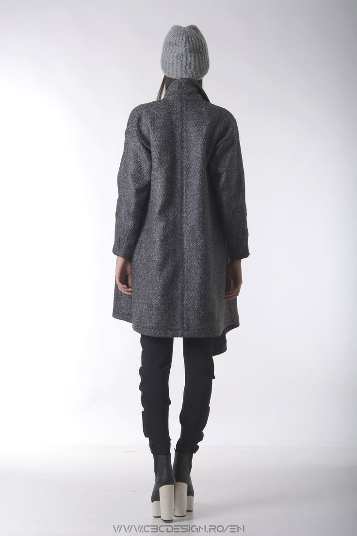 The texture of the GRAPHITE Overcoat is similar to stone and it has a mineral feel to it. The Oversized and loose design generates a series of looks and ways the coat could be worn and styled.