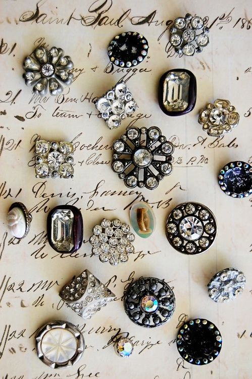 Display of vintage Rhinestone buttons on an old document ~