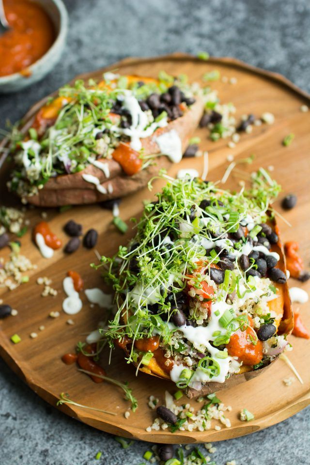 Loaded Sweet Potatoes with Quinoa Tabbouleh. Healthy and totally vegan, these baked sweet potatoes are topped with fresh, vibrant ingredients for a great, satisfying meal!