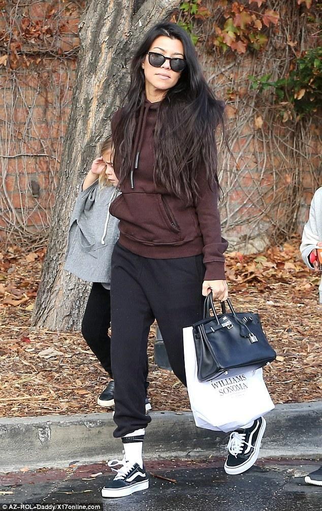 Kourtney Kardashian wearing Yeezy Adidas Originals by Kanye West Half Zip Hoodie, Saint Laurent Sl 93 Sunglasses, Hermes Birkin 25cm Black Togo Bag and Vans Old Skool Sneakers