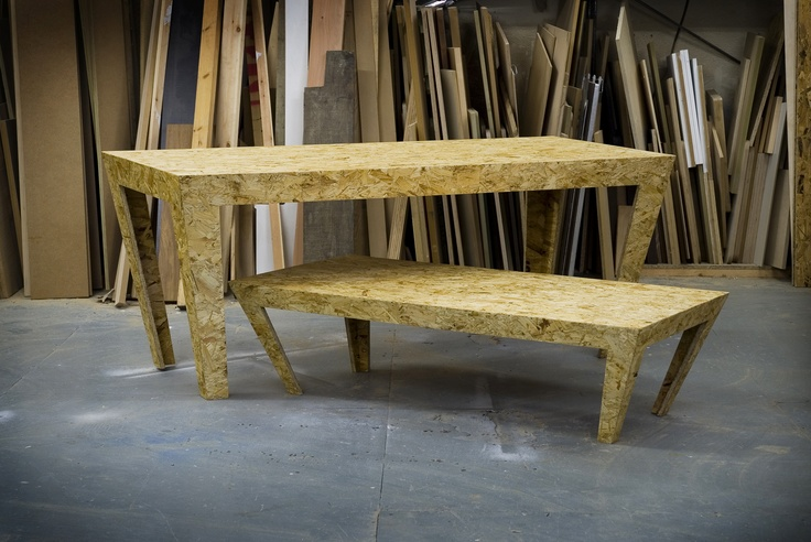 Compressed wood chip tables made of up to 65-90% recycled material.