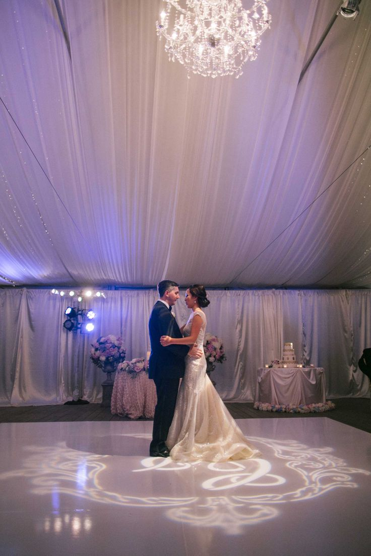 First Dance on Top of Monogram Gobo | Photography: Caroline Tran. Read More: http://www.insideweddings.com/weddings/magical-garden-ceremony-tented-reception-with-chic-french-theme/733/