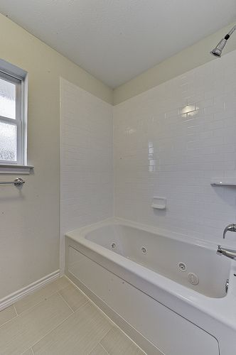 Renovation #3 - jack 'n jill bathroom with jetted tub and subway tile