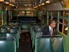 Barack Obama sitting in the bus Rosa Parks refused to give up her seat.