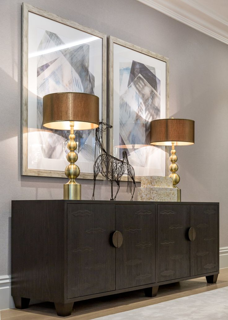 Matching abstract prints and warm brass lamps complete this magnificent ebonised oak Lipps Long cabinet with unique Cintamani 'bas relief' doors by Julian Chichester.