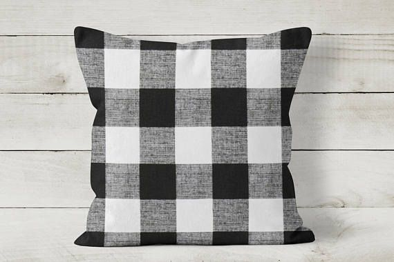 Add farmhouse style to your decor with this buffalo check pillow cover by Cozy Home Studio.