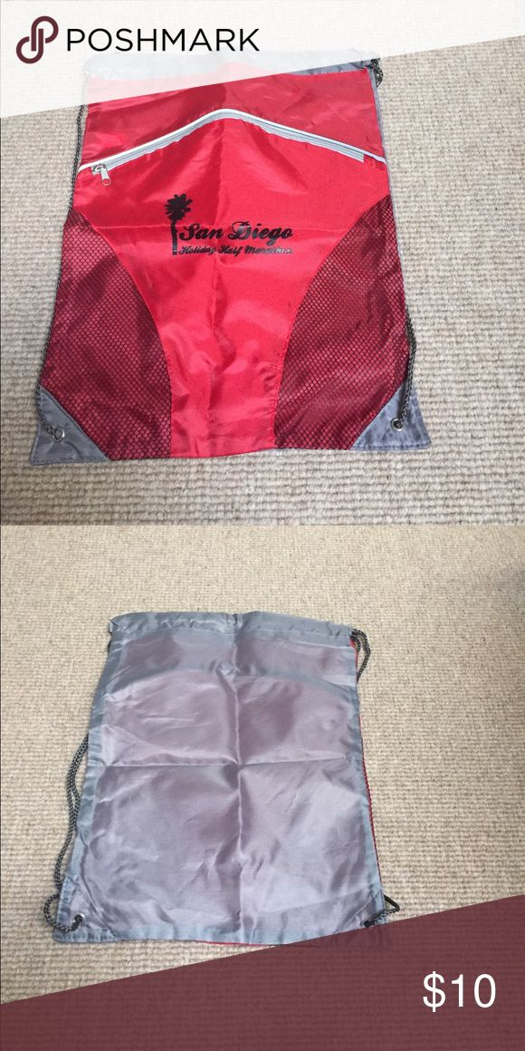 San Diego Holiday Half Marathon cinch bag Never used. Extra zippered pocket in front for additional space. Bags