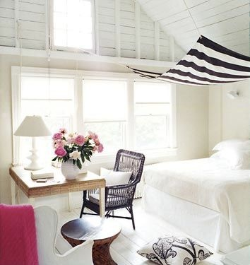 lots of white with black and white canopy and pops of pink for color
