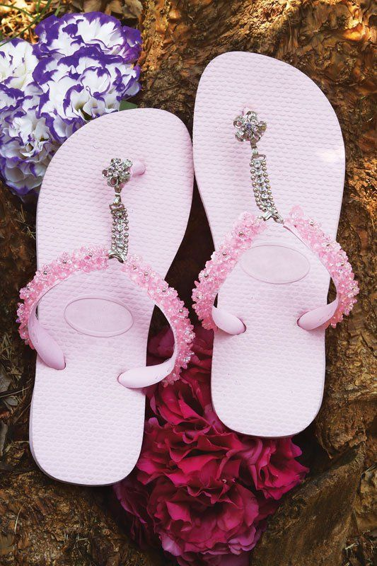 flip flops decorated with beads and chains