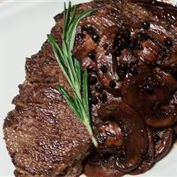 Merlot-Peppercorn Steak Sauce - 1 tablespoon butter  4 mushrooms, sliced  1 clove garlic, minced  2 tablespoons whole black peppercorns  4 tablespoons Merlot wine  1 tablespoon balsamic vinegar  3 tablespoons Worcestershire sauce  1/2 teaspoon minced fresh rosemary