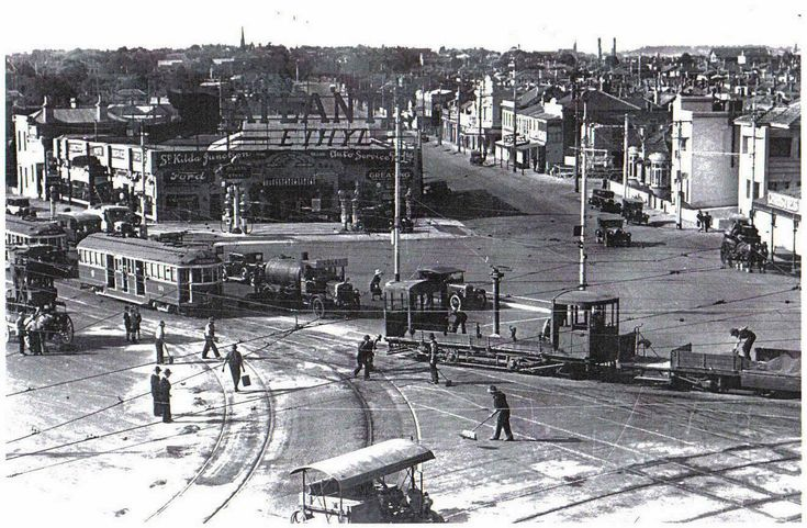 St Kilda Junction, in the background is the Junction Petrol Station  which was a feature of the Junction for many years.  (circa 1934)