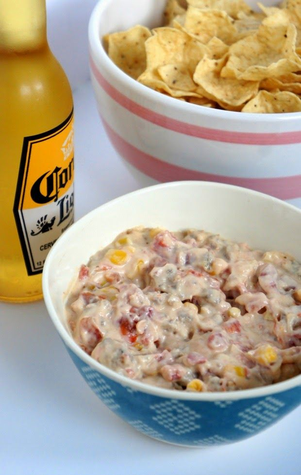 A Chip Dip You Must Make: Cowboy Crack // 1 pound sausage, 2 8 oz packages cream cheese, 2 cups Mozzarella, 1 cup frozen corn, 2 cans Rotel www.livinginyellow.com