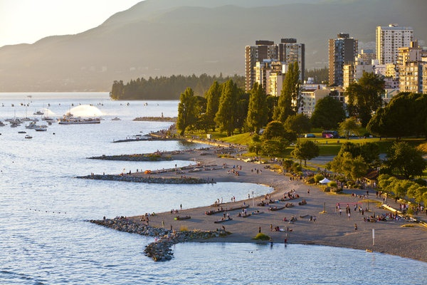 """This site is home to ten beaches, from the family-centric Jericho to the clothing-optional Wreck Beach, many of which offer views of the Vancouver skyline and North Shore Mountains. Sporty types prefer Kitsilano or """"Kits,"""" a six-minute drive from downtown, for its free tennis and basketball courts, and its heated saltwater pool."""