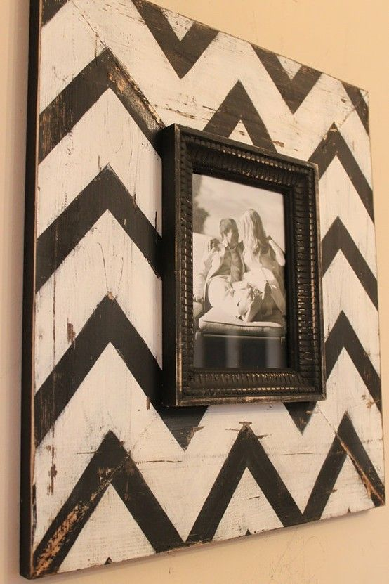 """(I love this idea!)I used 4 1/2"""" pieces of plywood cut 20"""" X 25"""" from our scrap wood pile. Rustic! I stained the pieces with """"Dark Walnut"""" stain to best match our decor and bought $4 frames from Walmart to glue onto the stained wood. I spray painted the frames with Rustoleum Heirloom white. I hung these in the hallway on top of our cowhide. LOOKS VERY CUTE!"""