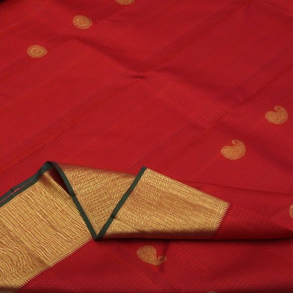 Like a bedecked blushing bride, sindoori red #silk is sprinkled with zigzag pattern in thread jacquard along with paisleys and chakrams in gold across the body. The big gold border is etched with slender lines like mehandi on a bride's radiant palms, and smeared with a slim line of green henna. The bejewelled pallu creates bridal magic. Perfectly complemented with a plain red blouse with running border. For saris in this exotic colour, visit #Sarangi. Code 460126604.